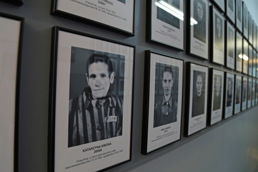 Identification photos of female prisoners on display in a former concentration camp bunker at Auschwitz I.  Prisoners who arrived at the camp for immediate execution were not photographed.